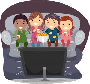 kids eating popcorn watching happy